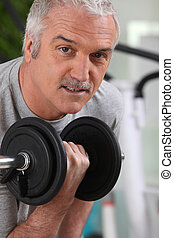 Man lifting a dumbbell at the gym