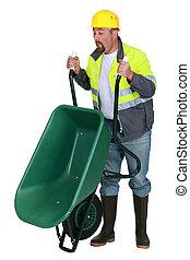 Man lifting a wheelbarrow