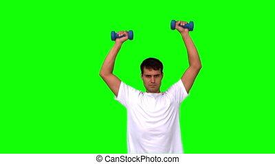 Man lifting dumbbells on green screen