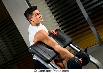 Man lifting dumbell in gym