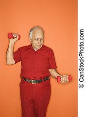 Man lifting hand weights.