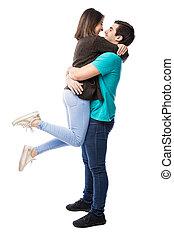 Man lifting his girlfriend in a hug