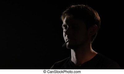 Man lighting cigarette. Black. Close up - Man lighting...