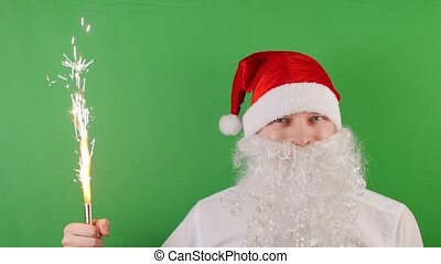 man like a Santa Claus with handheld fireworks candle or sparkler, christmas and New year 2019, on green Chroma key, looped cinemagraph