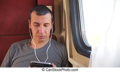 man listening lifestyle to the music on the train rail car...