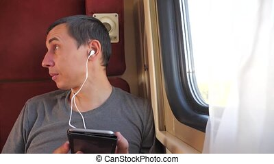 man listening to lifestyle the music on the train rail car...