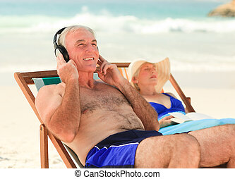 Man listening to music while his wi