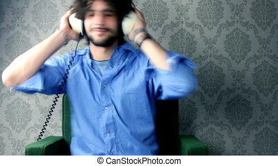 man listening to music with headphones