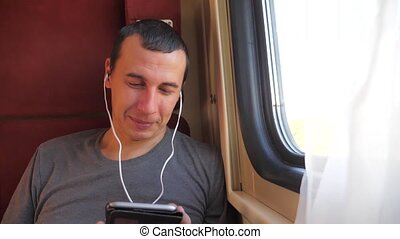 man listening to the music lifestyle on the train rail car...