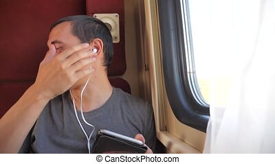 man listening to the music on lifestyle the train rail car...