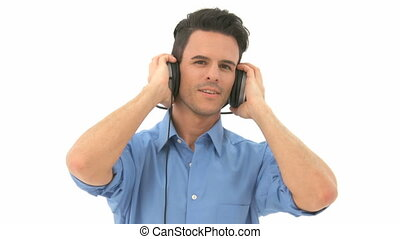 Man listens to music and moves