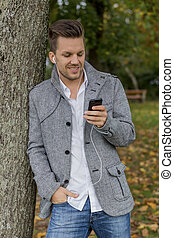 man listens to music on the mobile phone - a man listens to ...