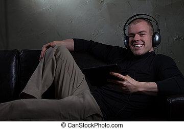 Man Listens to Music