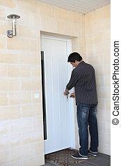 Man locking his door