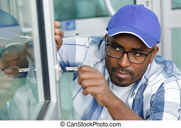 man locking or opening a double glazing window