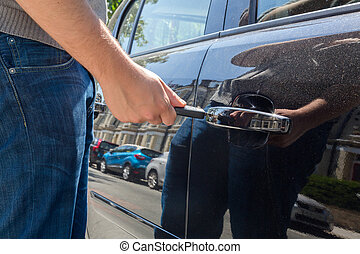 Man locking or unlocking a car door