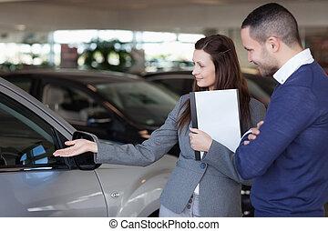 Man looking at a car