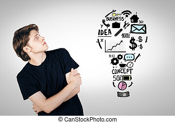 Man looking at business sketch - Handsome young man looking...
