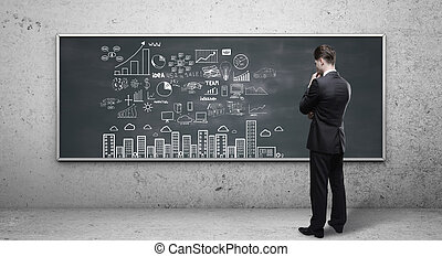 man looking at business strategy
