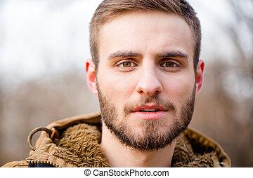 Man looking at camera outdoors