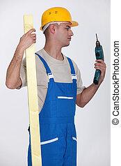 Man looking at drill