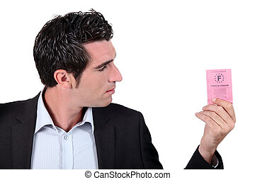 Man looking at driving licence