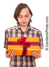 Man looking at gift