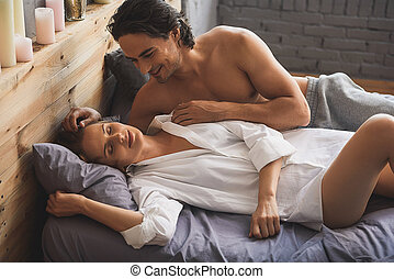 man looking at her girlfriend while she sleep