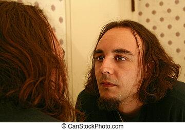 Man Looking At Himself On Mirror