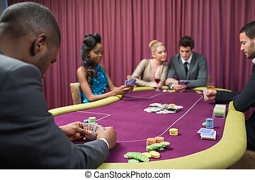 Man looking at his poker cards