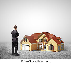 man looking at house