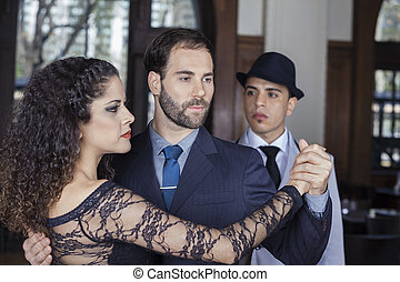 Man Looking At Male And Female Tango Dancers Performing Together