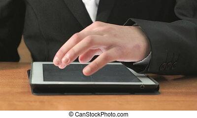 Man looking at photos using computer tablet