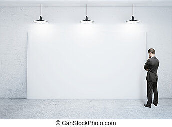 man looking at poster - businessman looking at blank poster