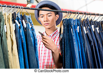 Man looking at price tag