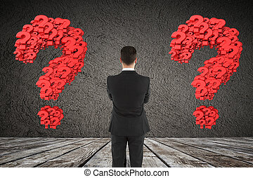 man looking at question mark