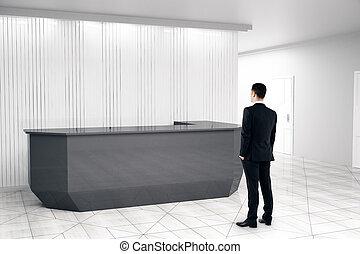 Man looking at reception desk