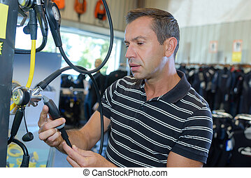Man looking at sports equipment