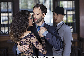 Man Looking At Tango Dancers Performing Together - Young man...