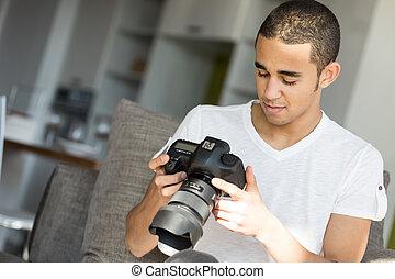 Man looking at the camera screen