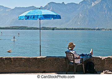 Man looking at the lake