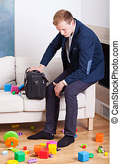 Man looking at the mess in his living room - Multifunctional...