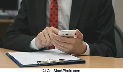 Man looking at the photos using cellphone indoors