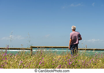 man in landscape looking at the sea