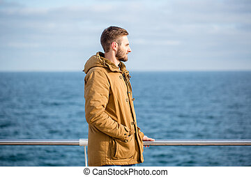 Man looking at the sea outdoors