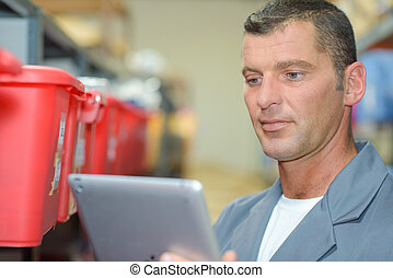 man looking at the tablet