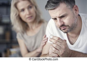 Man looking at wedding ring