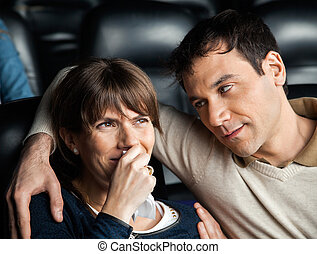 Man Looking At Woman Crying While Watching Movie
