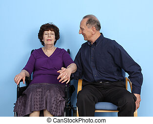 Man Looking At Woman On Wheelchair