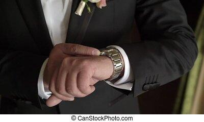 Man looking at wrist watches steadicam